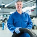 man holding tire
