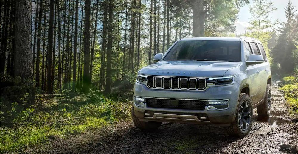 Jeep Wagoneer on a muddy trail