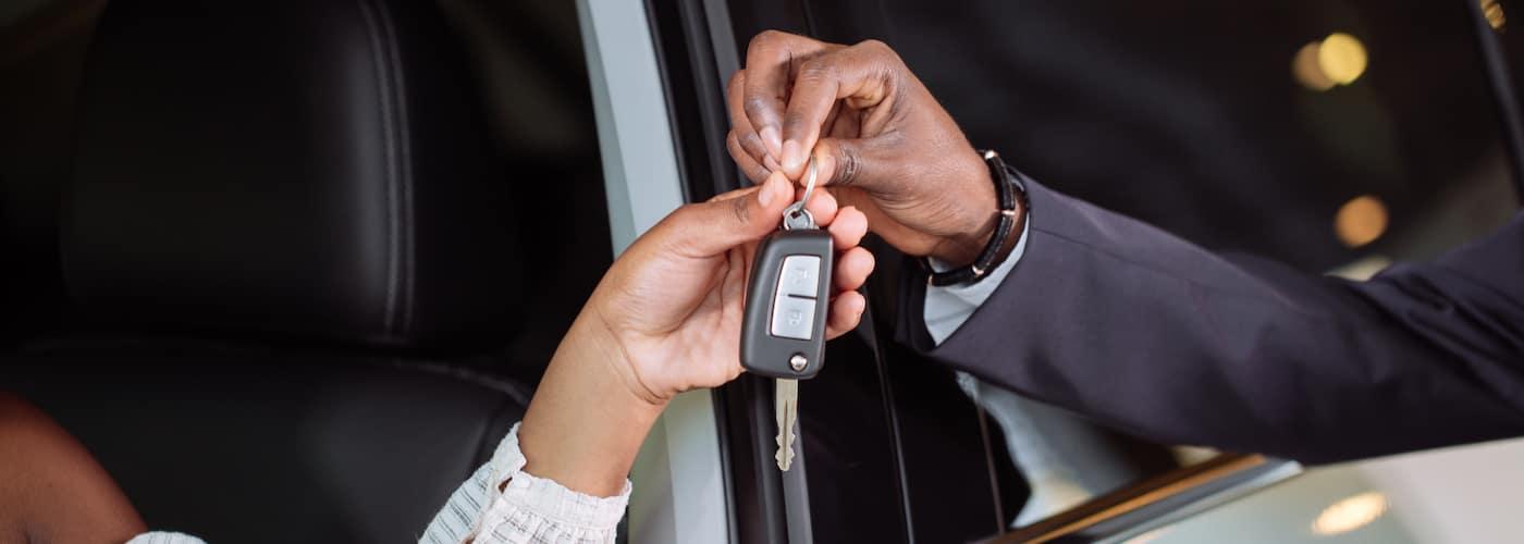 salesman handing over car keys