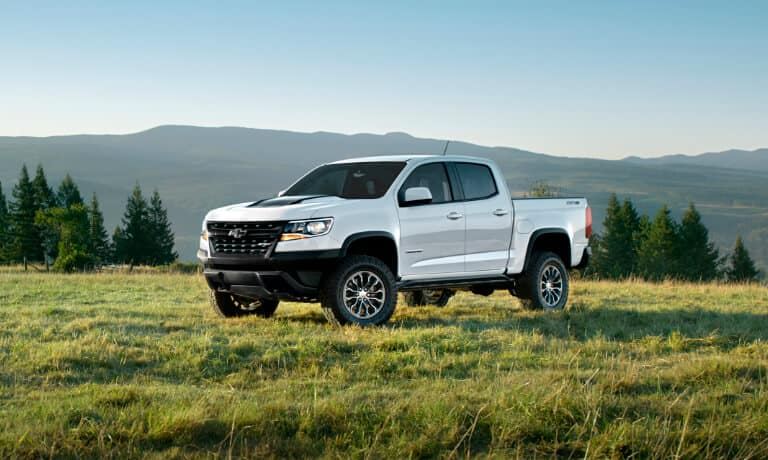 Chevy Colorado parked outside in a field