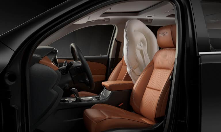2021 Chevy Traverse interior view with airbag deployed