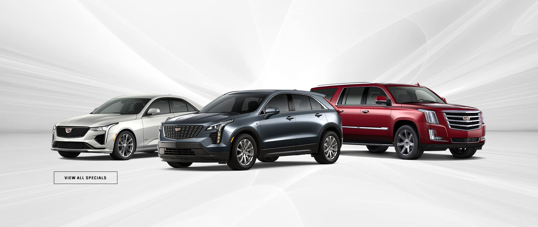 three Cadillacs with a button to view our dealership specials