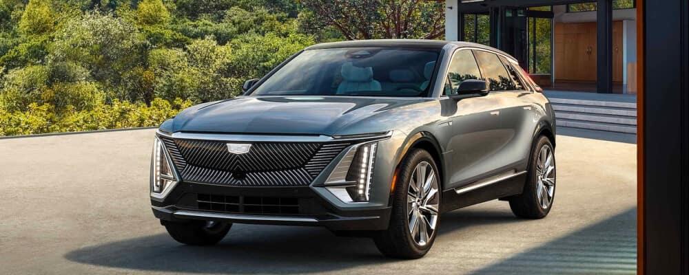 2023 Cadillac Lyriq parked near modern home
