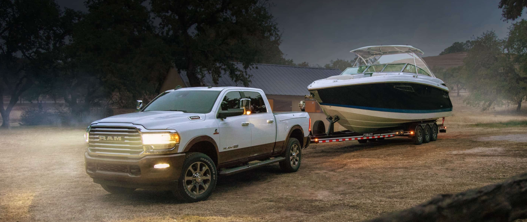 Ram towing a boat