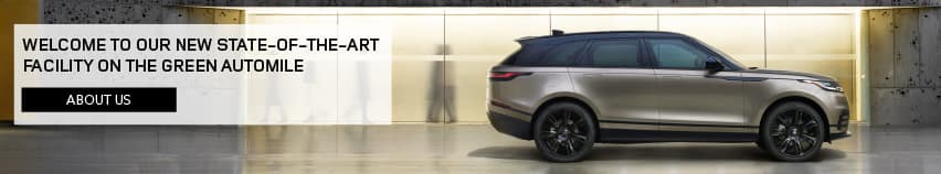 WELCOME TO OUR NEW STATE-OF-THE-ART FACILITY ON THE GREEN AUTOMILE. ABOUT US. SILVER RANGE ROVER VELAR PARKED.