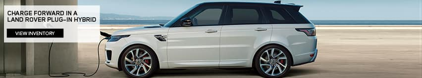CHARGE FORWARD IN A LAND ROVER PLUG-IN HYBRID. VIEW INVENTORY. WHITE RANGE ROVER SPORT PARKED ON BEACH.
