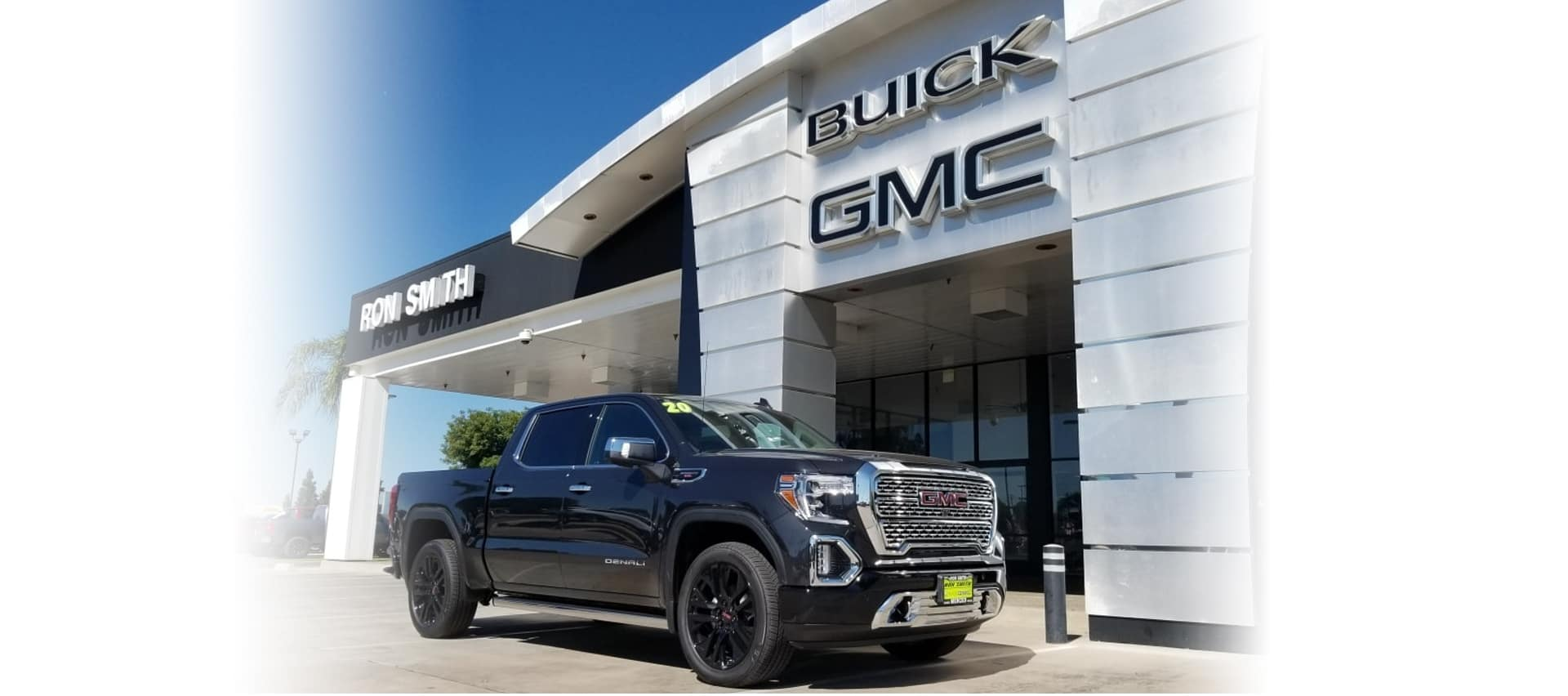 truck parked in front of dealership