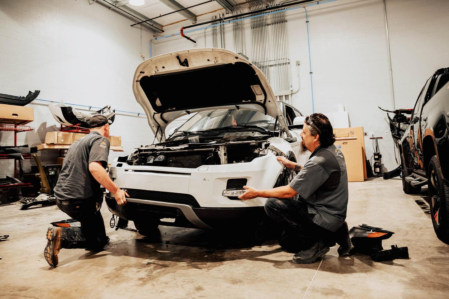 Uftring Body Shop Image - Uftring Certified Staff repair a vehicles front grill