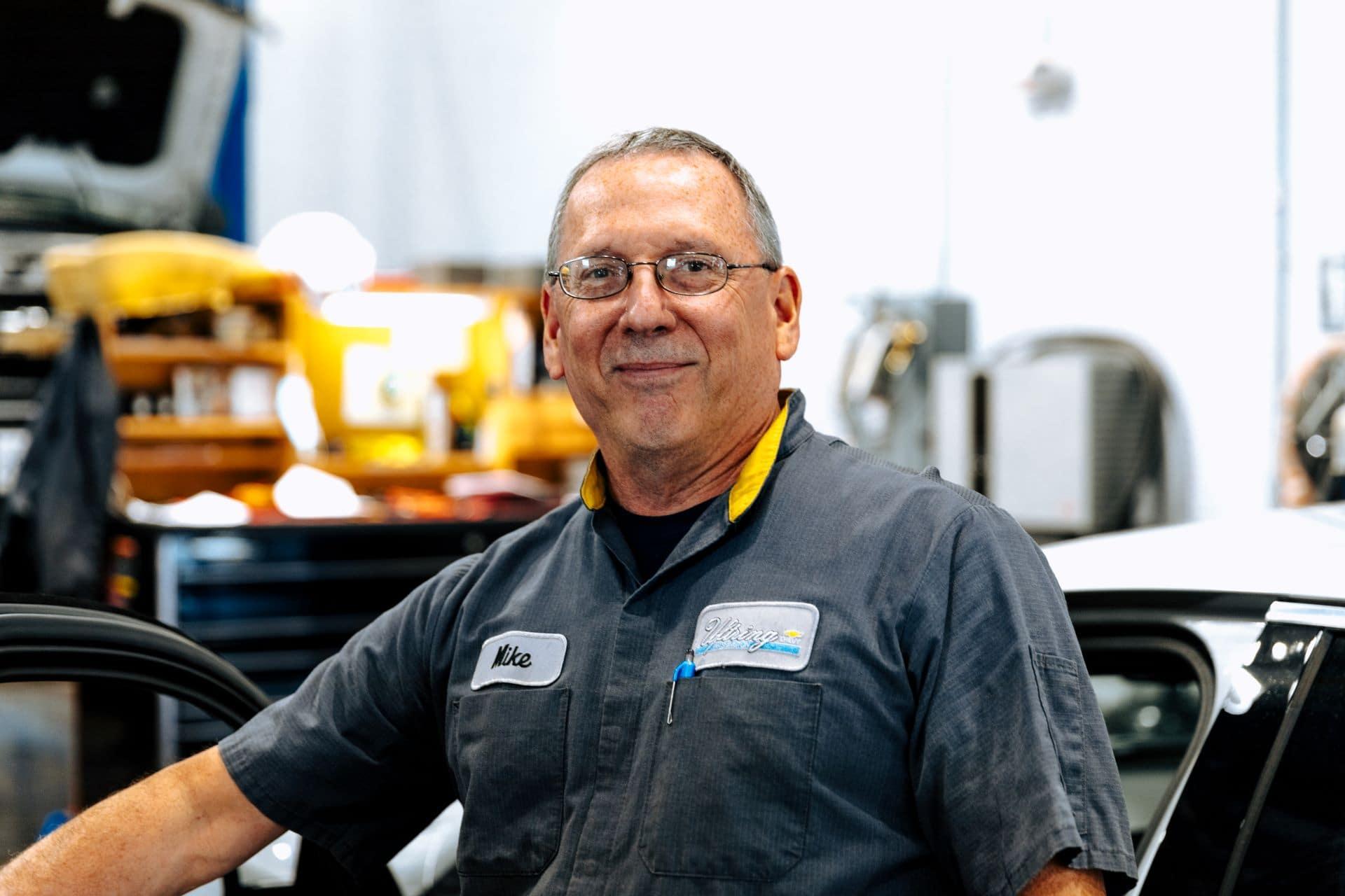 Service technician doing an oil change