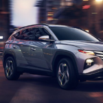 The 2022 Hyundai Tucson making a turn in a city.