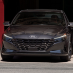 The 2022 Hyundai Elantra pulling out in a city like Orlando.