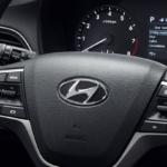 A steering wheel in a Hyundai model under $25,000.