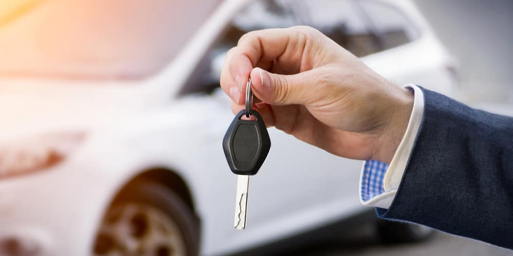 car key in front of new vehicle