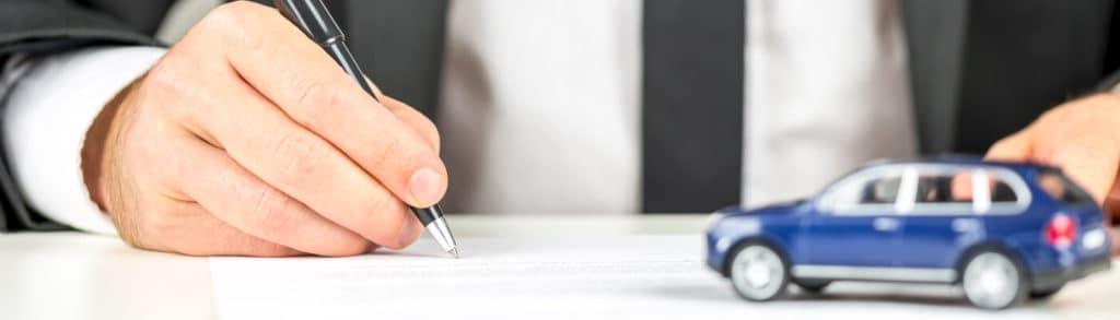 Car finance paperwork with little blue car