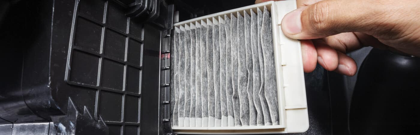Cabin air filter being replaced